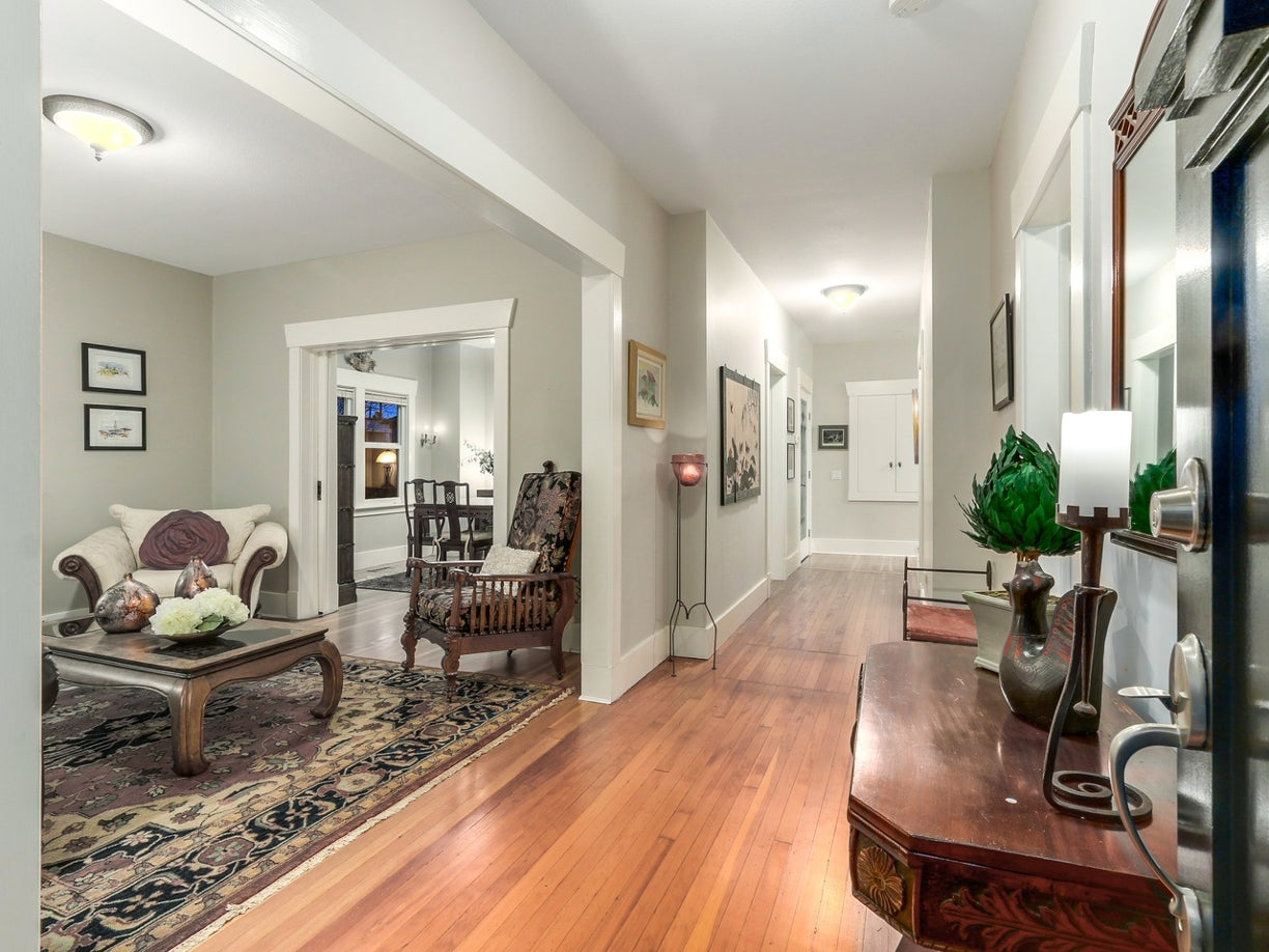 Boasting original hardwood, wide halls, this home is so full of character and ch