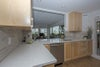 Cork floors, quartz counters, maple cabinets, stainless steel